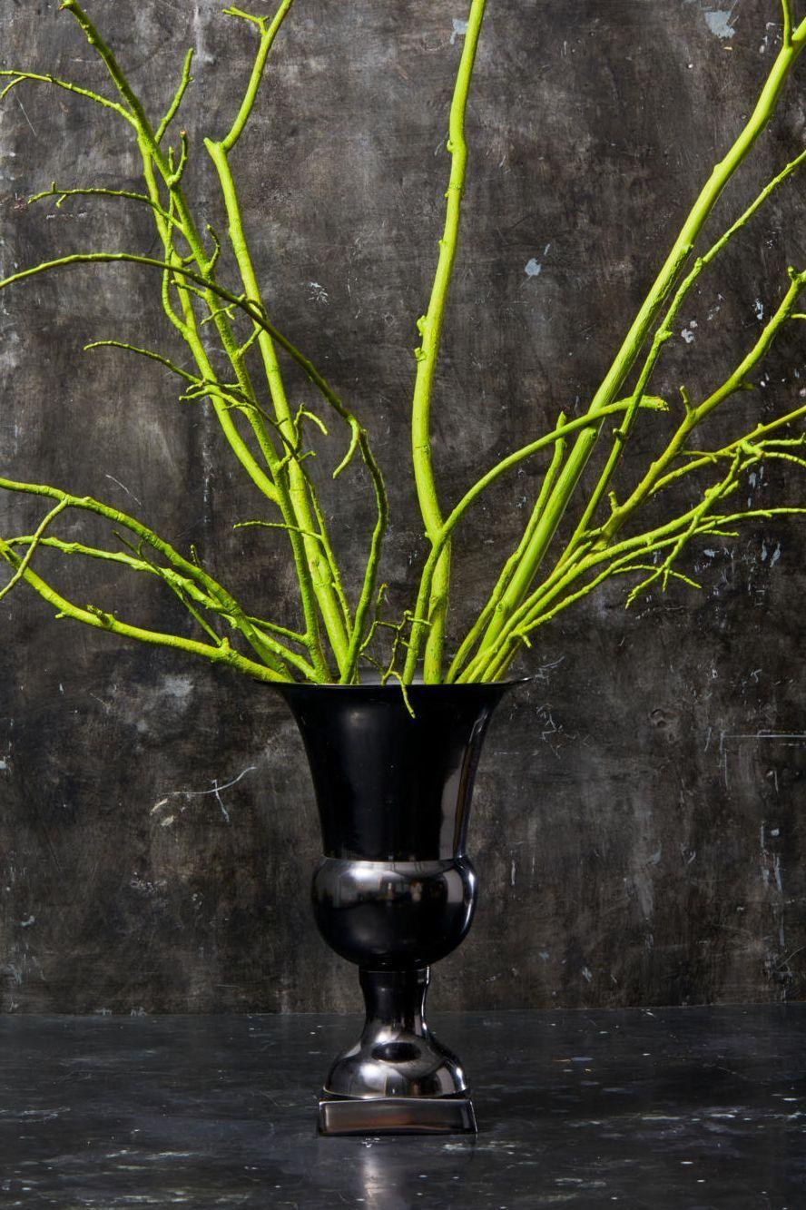 """<p>Spray paint tree branches right from your backyard in an electric green hue for an easy and striking centerpiece. Finish the look with a tall black vase. </p><p><a class=""""link rapid-noclick-resp"""" href=""""https://go.redirectingat.com?id=74968X1596630&url=https%3A%2F%2Fwww.homedepot.com%2Fpep%2FVillacera-18-in-Black-Decorative-Handcrafted-Bamboo-Jar-Vase-HWD020191%2F308776579&sref=https%3A%2F%2Fwww.goodhousekeeping.com%2Fholidays%2Fhalloween-ideas%2Fg33437890%2Fhalloween-table-decorations-centerpieces%2F"""" rel=""""nofollow noopener"""" target=""""_blank"""" data-ylk=""""slk:SHOP BLACK VASE"""">SHOP BLACK VASE</a></p>"""