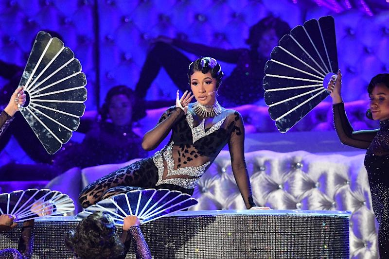 "Cardi B gyrated through her current hit ""Money"" at the Grammys, performing on a rhinestone-encrusted piano (AFP Photo/Robyn Beck)"