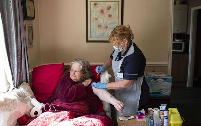 A housebound patient receives her vaccine in Chesterfield, Derbyshire - Oli Scarff/AFP