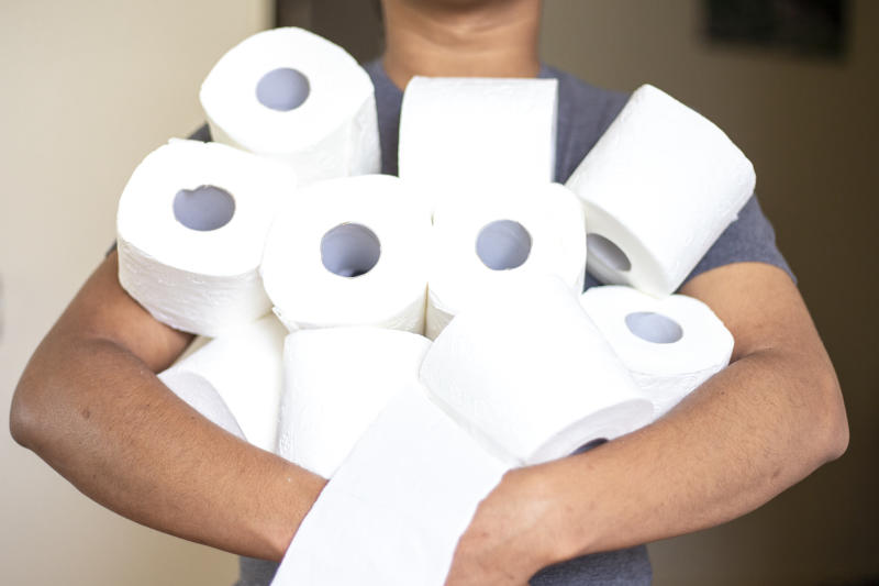 Asian Male Carry Toilet Paper