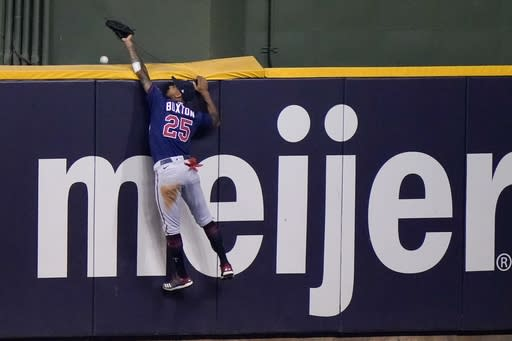 Minnesota Twins' Byron Buxton can't catch a two-run home run hit by Milwaukee Brewers' Jedd Gyorko during the eighth inning of a baseball game Tuesday, Aug. 11, 2020, in Milwaukee. (AP Photo/Morry Gash)