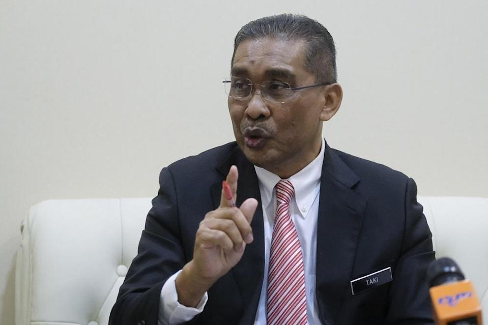 Minister in charge of parliament and law Datuk Takiyuddin Hassan speaks during a press conference in Putrajaya May 8, 2020. — Bernama pic