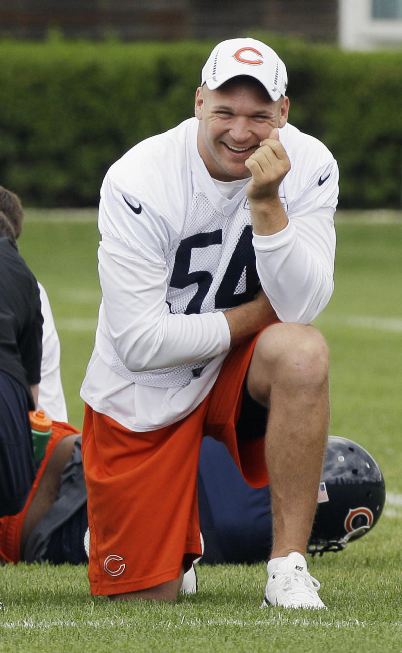 FILE - In this May 30, 2012 file photo, Chicago Bears linebacker Brian Urlacher watches teammates practice during an NFL football practice in Lake Forest, Ill. The Bears say Urlacher underwent arthroscopic surgery on his left knee Tuesday, Aug. 14, 2012 and still hopes to be ready for the season opener Sept. 9. Urlacher was ready for the start of training camp but has not practiced since July 31. (AP Photo/Nam Y. Huh, File)