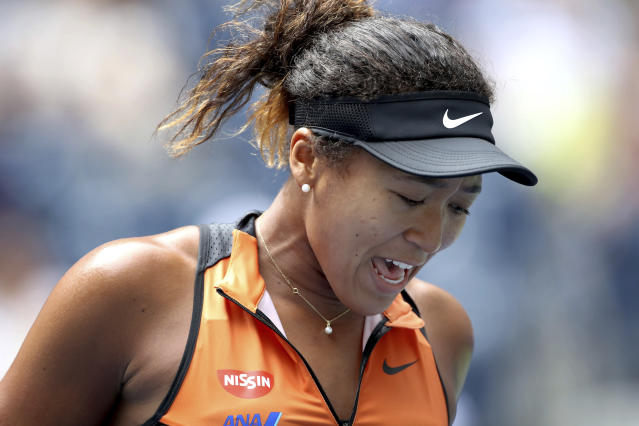 Naomi Osaka, of Japan, reacts after losing a point to Anna Blinkova, of Russia, during the first round of the US Open tennis tournament Tuesday, Aug. 27, 2019, in New York. (AP Photo/Michael Owens)
