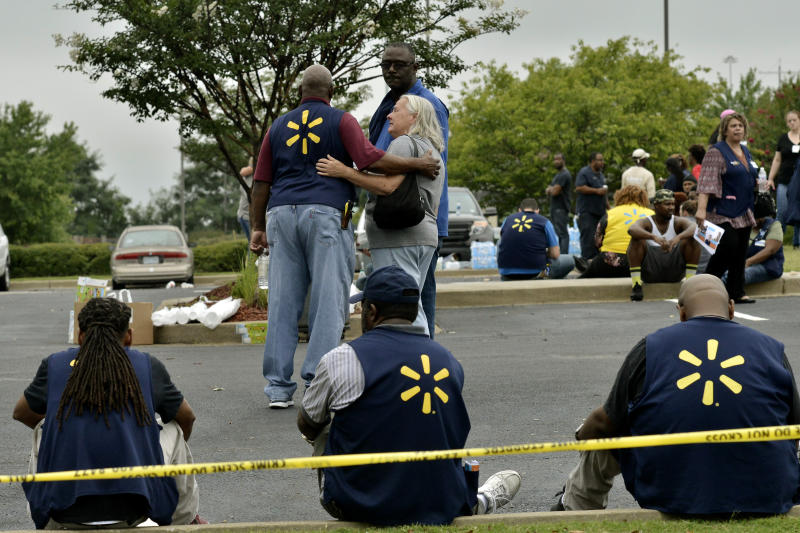 Walmart employees gather in a nearby parking lot after a shooting at the store, Tuesday, July 30, 2019, in Southaven, Miss. A gunman fatally shot two people and wounded a police officer before he was shot and arrested Tuesday at the Walmart in northern Mississippi, authorities said.   (AP Photo/Brandon Dill)