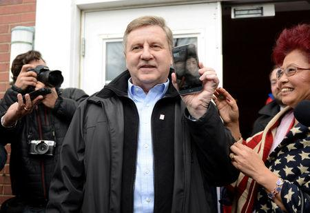 U.S. congressional candidate and State Rep. Rick Saccone emerges from his polling place while video chatting with his son at the Osan Air Base in South Korea.  Saccone cast  his vote in Pennsylvania's 18th U.S. Congressional district special election between Republican Saccone and Democratic candidate Conor Lamb at a polling place in McKeesport, Pennsylvania, U.S., March 13, 2018. REUTERS/Alan Freed