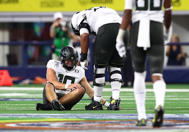 Oregon Ducks quarterback Justin Herbert (10) sits on the field hurt in the fourth quarter against the Auburn Tigers at AT&T Stadium. (USA Today)