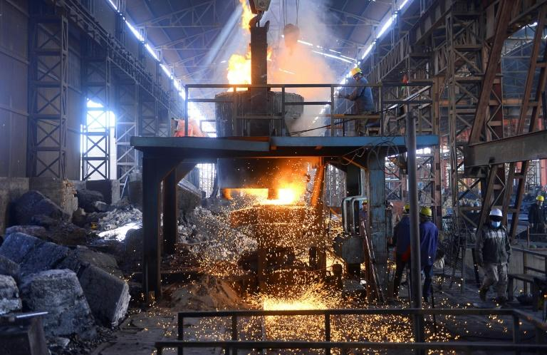 Afghan labourers meltdown the wreckage of Soviet-era machines in an iron factory on the outskirts of western Herat province