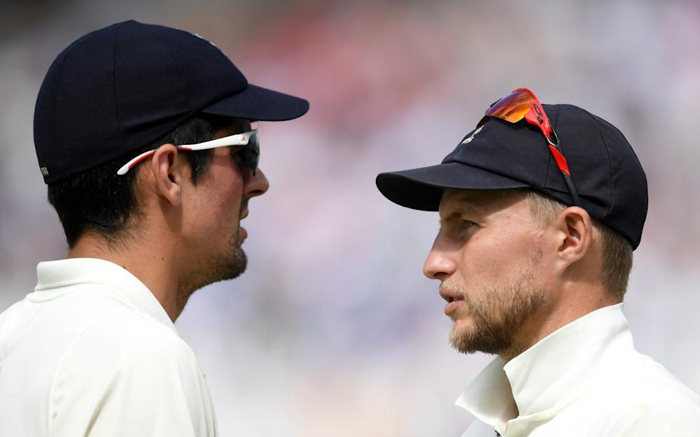 England captain Joe Root speaks with Alastair Cook during day three of the 2nd Investec Test match between England and South Africa - Credit: Getty Images