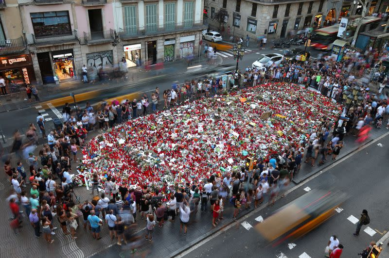 FILE PHOTO: People gather at an impromptu memorial in Barcelona