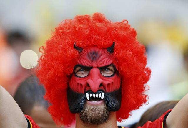 A fan of Belgium wearing a mask, cheers before their 2014 World Cup Group H soccer match against Algeria at the Mineirao stadium in Belo Horizonte June 17, 2014. REUTERS/Sergio Perez (BRAZIL - Tags: SOCCER SPORT WORLD CUP TPX IMAGES OF THE DAY)