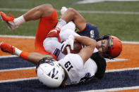 Northwestern wide receiver Riley Lees (19) catches a touchdown pass as Illinois defensive back Sydney Brown (30) defends during the second half of an NCAA college football game Saturday, Nov. 30, 2019, in Champaign , Ill. Northwestern won 29-10. (AP Photo/Charles Rex Arbogast)