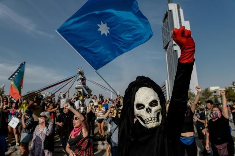 A demonstrator gestures during a protest against the government of Chilean President Sebastian Pinera in Santiago on January 24, 2020