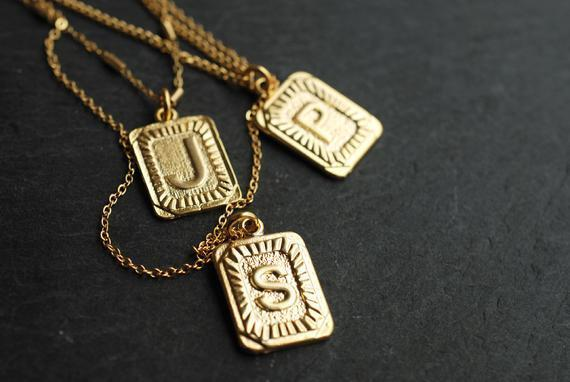 """<h3><a href=""""https://www.etsy.com/listing/645000567/initial-necklace-statement-necklace-name"""" rel=""""nofollow noopener"""" target=""""_blank"""" data-ylk=""""slk:Picturing Initial Necklace"""" class=""""link rapid-noclick-resp"""">Picturing Initial Necklace</a></h3><br>These under-$30 necklaces have a """"found"""" feel that will definitely delight your mom, no matter her style.<br><br><strong>Picturing</strong> Initial Necklace, $, available at <a href=""""https://go.skimresources.com/?id=30283X879131&url=https%3A%2F%2Fwww.etsy.com%2Flisting%2F645000567%2Finitial-necklace-statement-necklace-name%3F"""" rel=""""nofollow noopener"""" target=""""_blank"""" data-ylk=""""slk:Etsy"""" class=""""link rapid-noclick-resp"""">Etsy</a>"""