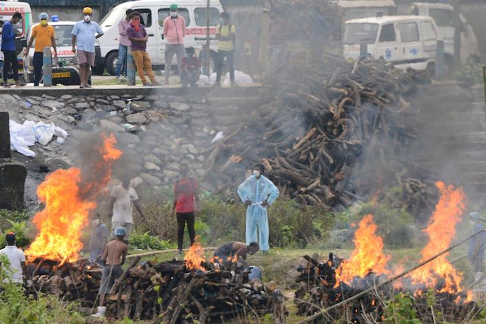 People watch the cremation of people who died due to the COVID-19 at Sahudangi Crematorium, about 9 miles from Siliguri, India, May 4, 2021. / Credit: DIPTENDU DUTTA/AFP/Getty