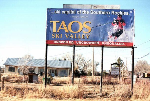PHOTO: A billboard for Taos Ski Valley in New Mexico stands above barren ground, Feb. 9, 2000. (Joe Raedle/Getty Images, FILE)