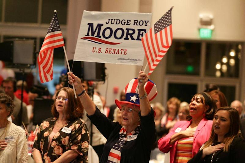 Moore's supporters include hardcore Christian conservatives (Reuters)