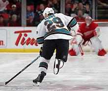 Ryane Clowe #29 of the Sharks skates in for a shoot-out attempt on Jimmy Howard #35 of the Red Wings in 2010