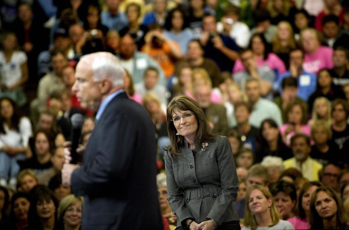 """John McCain, 2008 Republican presidential candidate, and Sarah Palin, his vice presidential nominee, respond to angry supporters worried about """"socialists taking over our country."""""""