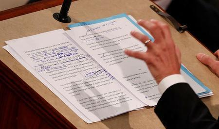 Hand written edits can he seen on French President Emmanuel Macron's speech in the section regarding the JCPOA Iran nuclear agreement as he addresses a joint meeting of the U.S. Congress in the House chamber of the U.S. Capitol in Washington, U.S., April 25, 2018. REUTERS/Jonathan Ernst