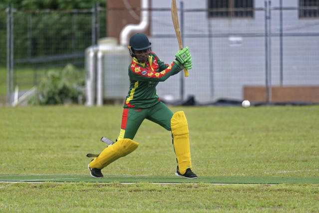 In this May, 2019, photo provided by the Vanuatu Cricket Association Valenta Langiatu bats during a women's cricket match in Port Vila, Vanuatu. The tropical island in the South Pacific is very likely to be the only venue in the world hosting a competitive cricket final on Saturday, as most international sport remains shuttered around the globe. (Ron Zwiers/Vanuatu Cricket Association via AP)
