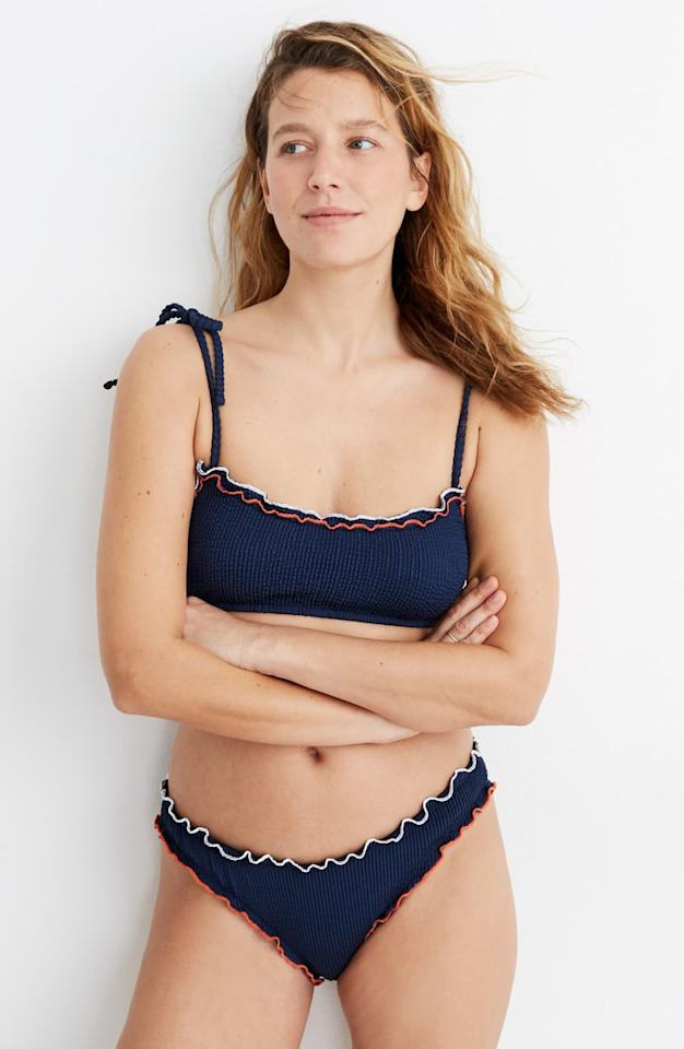 """<p>This <a href=""""https://www.popsugar.com/buy/Madewell-Second-Wave-Ruffle-Edge-Textured-Curved-Waist-Bikini-Bottoms-556124?p_name=Madewell%20Second%20Wave%20Ruffle-Edge%20Textured%20Curved-Waist%20Bikini%20Bottoms&retailer=shop.nordstrom.com&pid=556124&price=45&evar1=fab%3Aus&evar9=47301006&evar98=https%3A%2F%2Fwww.popsugar.com%2Ffashion%2Fphoto-gallery%2F47301006%2Fimage%2F47301016%2FMadewell-Second-Wave-Ruffle-Edge-Textured-Curved-Waist-Bikini-Bottoms-Top&list1=shopping%2Cnordstrom%2Cone-piece%2Cswimsuits%2Cbikinis&prop13=mobile&pdata=1"""" rel=""""nofollow"""" data-shoppable-link=""""1"""" target=""""_blank"""" class=""""ga-track"""" data-ga-category=""""Related"""" data-ga-label=""""https://shop.nordstrom.com/s/madewell-second-wave-ruffle-edge-textured-curved-waist-bikini-bottoms/5505902/full?origin=category-personalizedsort&amp;breadcrumb=Home%2FWomen%2FClothing%2FSwimsuits%20%26%20Cover-Ups&amp;color=bengali%20indigo"""" data-ga-action=""""In-Line Links"""">Madewell Second Wave Ruffle-Edge Textured Curved-Waist Bikini Bottoms</a> ($45) and <a href=""""https://www.popsugar.com/buy/Top-556149?p_name=Top&retailer=shop.nordstrom.com&pid=556149&price=50&evar1=fab%3Aus&evar9=47301006&evar98=https%3A%2F%2Fwww.popsugar.com%2Ffashion%2Fphoto-gallery%2F47301006%2Fimage%2F47301016%2FMadewell-Second-Wave-Ruffle-Edge-Textured-Curved-Waist-Bikini-Bottoms-Top&list1=shopping%2Cnordstrom%2Cone-piece%2Cswimsuits%2Cbikinis&prop13=mobile&pdata=1"""" rel=""""nofollow"""" data-shoppable-link=""""1"""" target=""""_blank"""" class=""""ga-track"""" data-ga-category=""""Related"""" data-ga-label=""""https://shop.nordstrom.com/s/madewell-second-wave-ruffle-edge-textured-tie-strap-bikini-top/5505910/full?origin=category-personalizedsort&amp;breadcrumb=Home%2FWomen%2FClothing%2FSwimsuits%20%26%20Cover-Ups&amp;color=bengali%20indigo"""" data-ga-action=""""In-Line Links"""">Top</a> ($50) is so cute.</p>"""