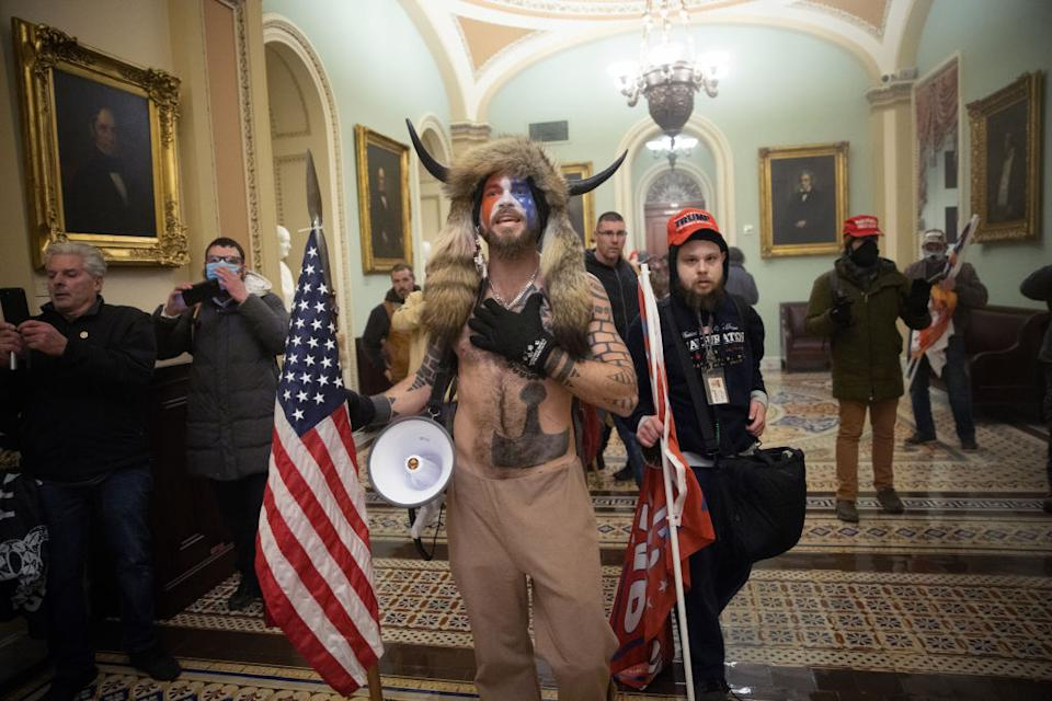A pro-Trump mob confronts US Capitol police outside the Senate chamber of the U.S. Capitol Building in Washington, DC.