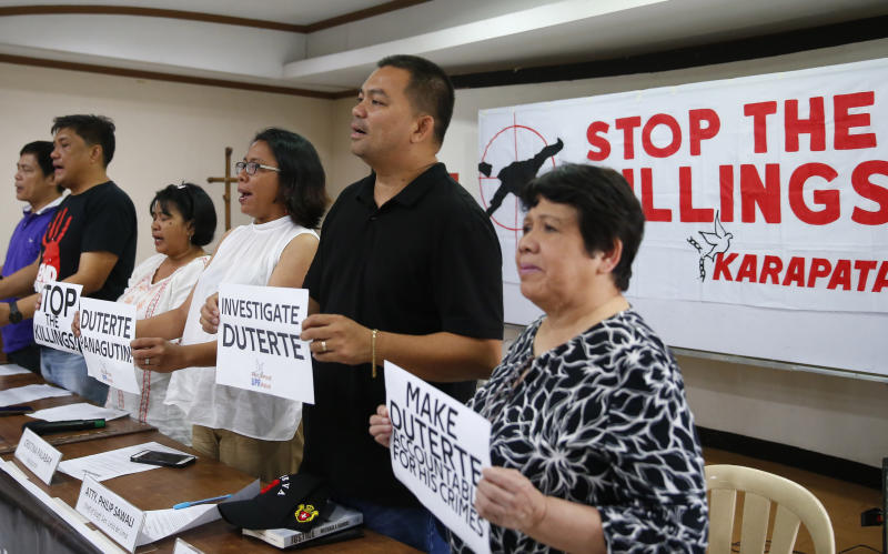 Human rights advocates display placards during a news conference following the United Nations Human Rights Council's resolution in Geneva, Friday, July 12, 2019 in suburban Quezon city, northeast of Manila, Philippines. The U.N.'s top human rights body has narrowly passed a resolution that includes calls for greater scrutiny in the Philippines. (AP Photo/Bullit Marquez)