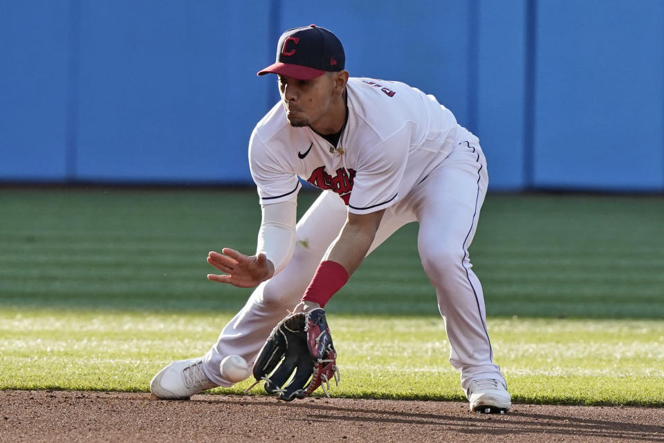 Cleveland Indians' Andres Gimenez fields a ball hit by Cincinnati Reds' Tyler Stephenson, who was out at first during the fourth inning of a baseball game Saturday, May 8, 2021, in Cleveland. (AP Photo/Tony Dejak)
