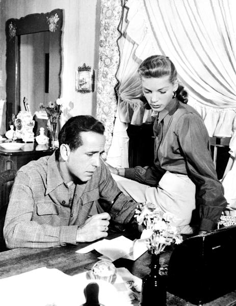 US actor, director, producer Humphrey Bogart (1899-1957) beside his wife actress Lauren Bacall in 1948 (AFP Photo/Corr)