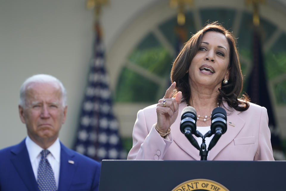 President Joe Biden listens as Vice President Kamala Harris speaks before he signs a bill in the Rose Garden of the White House, in Washington, Thursday, Aug. 5, 2021, that awards Congressional gold medals to law enforcement officers that protected members of Congress at the Capitol during the Jan. 6 riot. (AP Photo/Susan Walsh)