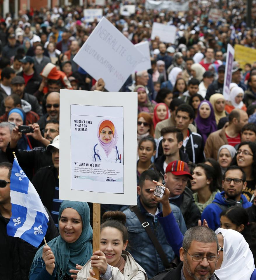 Demonstrators protest against Quebec's proposed Charter of Values in Montreal, September 14, 2013. Thousands took to the streets to denounce the province's proposed bill to ban the wearing of any overt religious garb by government paid employees. REUTERS/ Christinne Muschi (CANADA - Tags: POLITICS CIVIL UNREST RELIGION)