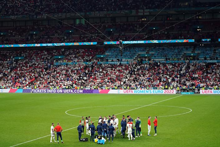 England players ahead of extra time during the UEFA Euro 2020 Final at Wembley Stadium, London. Picture date: Sunday July 11, 2021.