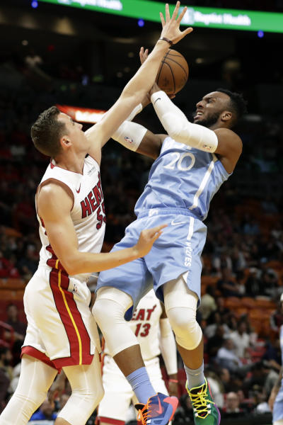 Minnesota Timberwolves guard Josh Okogie (20) attempts a shot against Miami Heat guard Duncan Robinson (55) during the first half of an NBA basketball game, Wednesday, Feb. 26, 2020, in Miami. (AP Photo/Wilfredo Lee)