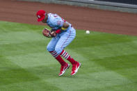St. Louis Cardinals right fielder Justin Williams (26) misses a ball that went for a double during the third inning of a baseball game, Saturday, April 17, 2021, in Philadelphia. (AP Photo/Laurence Kesterson)