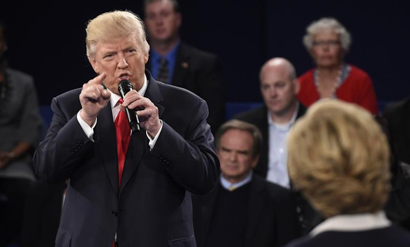 Donald Trump speaks as Hillary Clinton listens during a presidential town hall debate at Washington University in St. Louis on Oct 9. (Photo: Saul Loeb/Pool/Reuters)