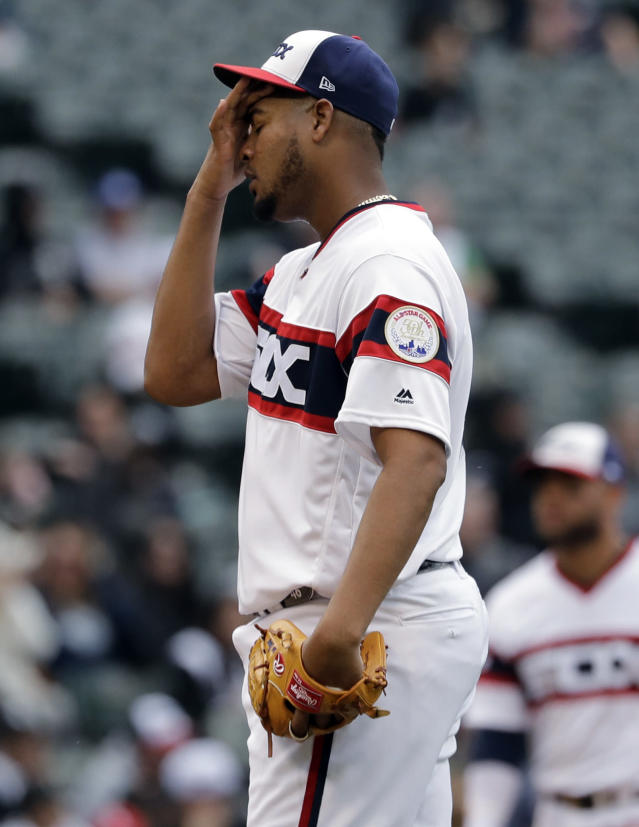 Chicago White Sox starting pitcher Ivan Nova reacts after Seattle Mariners' Tim Beckham walked to first during the third inning of a baseball game in Chicago, Sunday, April 7, 2019. (AP Photo/Nam Y. Huh)