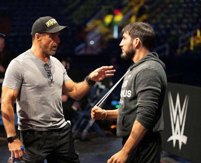 WWE legend Shawn Michaels speaks with Johnny Gargano before an NXT event. (Photo Courtesy of WWE)