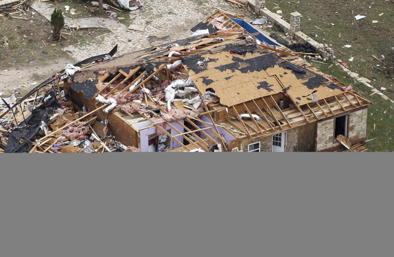 A heavily damaged home in Granbury, Texas is seen in an aerial view on Thursday May 16, 2013. Ten tornadoes touched down in several small communities in North Texas overnight, leaving at least six people dead, dozens injured and hundreds homeless.    (AP Photo/The Fort Worth Star-Telegram, Ron T. Ennis)  MAGS OUT