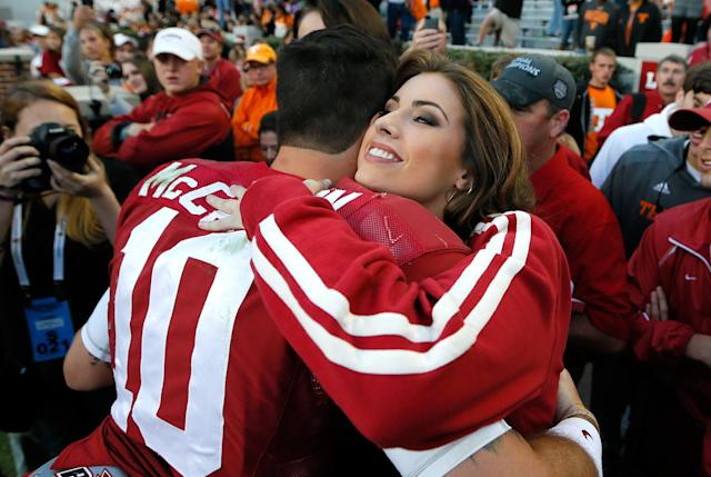TUSCALOOSA, AL - OCTOBER 26: AJ McCarron #10 of the Alabama Crimson Tide hugs girlfriend Katherine Webb after their 45-10 win over the Tennessee Volunteers at Bryant-Denny Stadium on October 26, 2013 in Tuscaloosa, Alabama. (Photo by Kevin C. Cox/Getty Images)