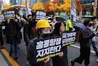 Students and young people chant slogans during a demonstration to support Hong Kong pro-democracy protesters in Seoul