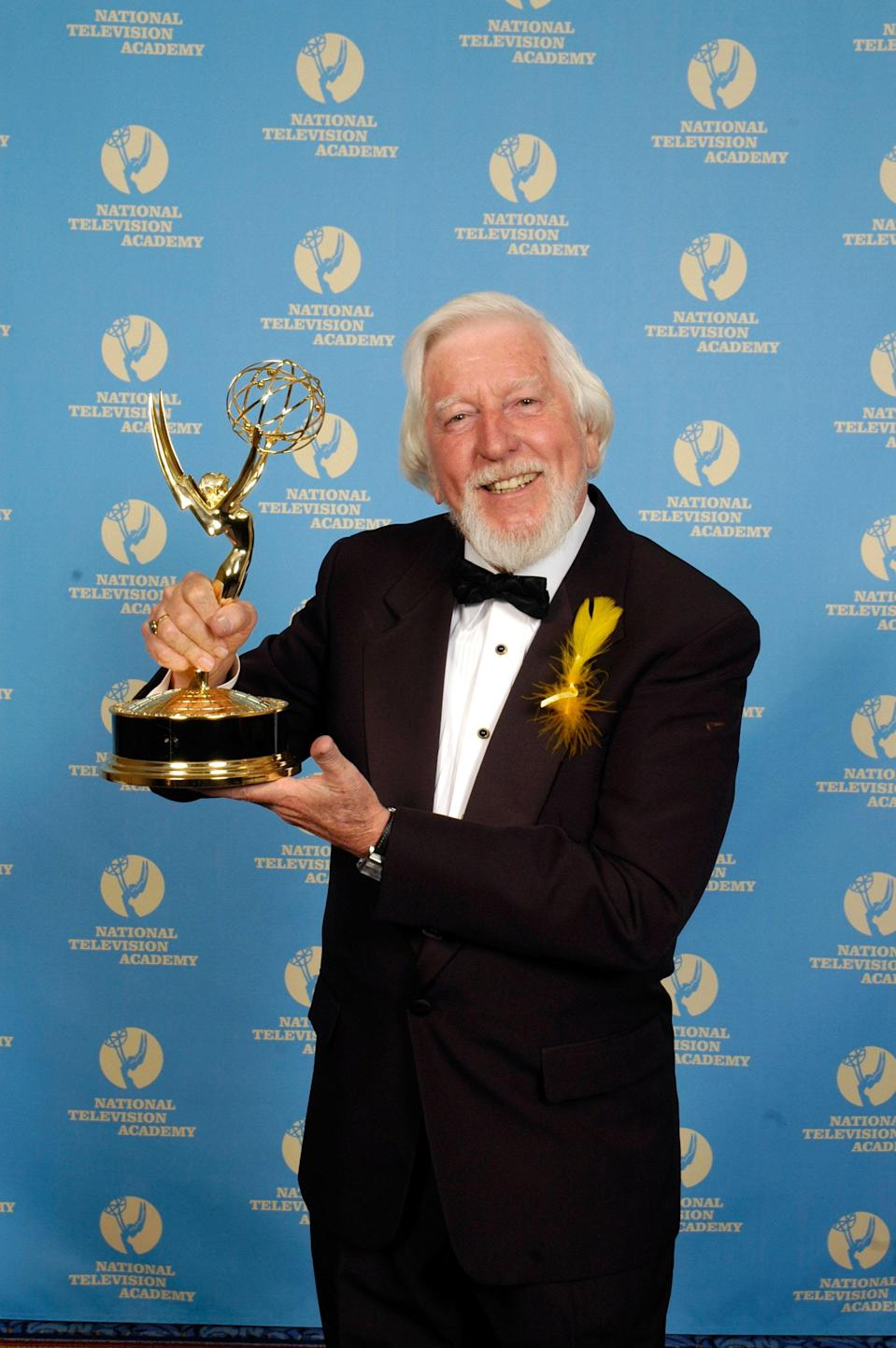 Spinney, sporting a Big Bird feather, with his Lifetime Achievement Award at the 2006 Daytime Emmys. (Photo: Marc Bryan-Brown/WireImage)