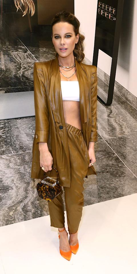 <p>During the MIRROR Westfield Century City grand opening, Kate Beckinsale wore a leather suit with Dru jewelry, L'Afshar bag, and Olgana Paris shoes.</p>