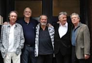 FILE PHOTO: Members of British comedy troupe Monty Python pose for a photograph during a media event in central London