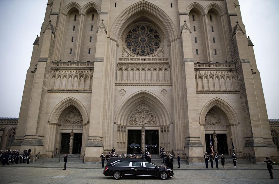 The hearse carrying the casket of former President George H.W. Bush arrives at the National Cathedral during a state funeral service in Washington, D.C., on Wednesday, Dec. 5, 2018. (Photo: Al Drago/Bloomberg via Getty Images)