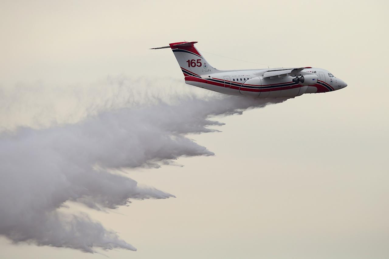 <p>A Large Air Tanker performs a final test for the 2018/19 Bush Fire Season at the RAAF Base Richmond on August 31, 2018 in Sydney, Australia. Nicknamed 'Boomer' the RJ-45 aircraft is one of four LATs being used for the bushfire season and can dump more than 11,300 litres of water or fire retardant at a time. (Photo by Jason McCawley/Getty Images) </p>