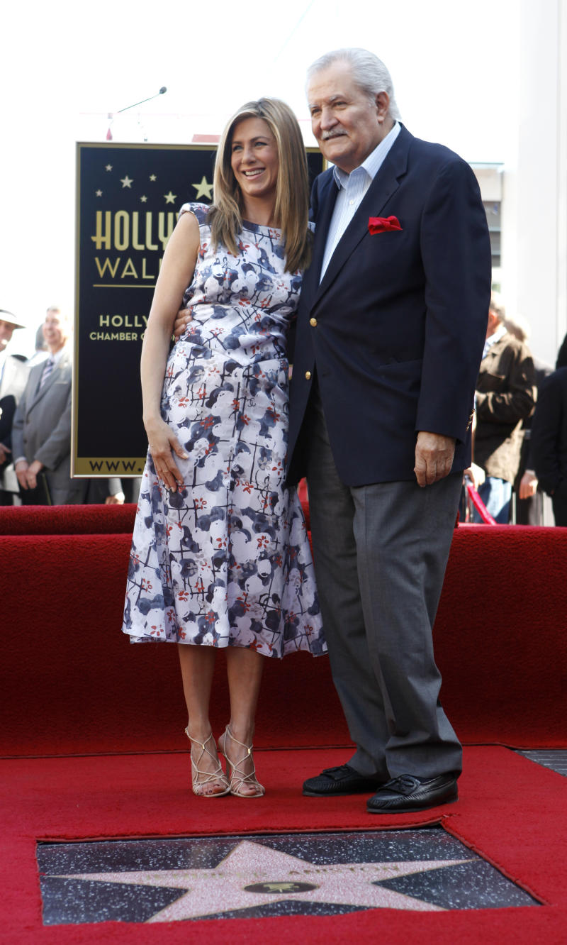 Actress Jennifer Aniston and her dad John Aniston pose with her new Star On The Hollywood Walk Of Fame on February 22, 2012 in Hollywood, California