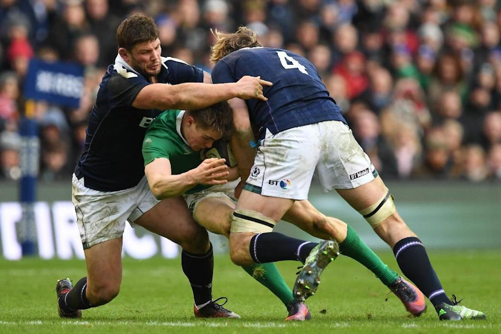 Ireland's centre Garry Ringrose (C) is tackled by Scotland's lock Richie Gray (R) during the Six Nations international rugby union match between Scotland and Ireland at Murrayfield in Edinburgh, Scotland on Febuary 4, 2017. (AFP Photo/Paul ELLIS)