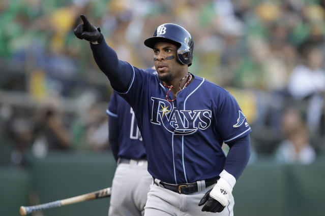 Tampa Bay Rays' Yandy Diaz gestures after hitting a solo home run against the Oakland Athletics during the first inning of an American League wild-card baseball game in Oakland, Calif., Wednesday, Oct. 2, 2019. (AP Photo/Ben Margot)