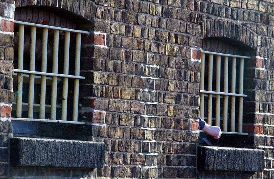 Prison bars (Andrew Parsons/PA) (PA Archive)